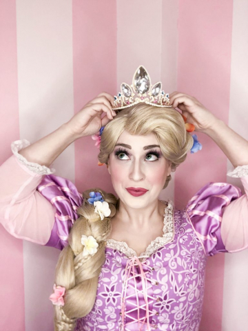 Rapunzel is wearing her crown and looking up.