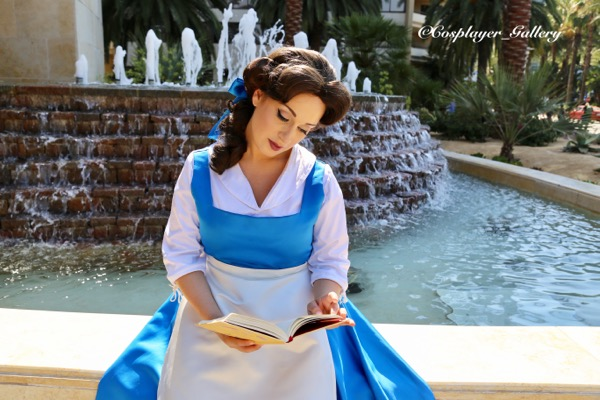 Princess Beauty reading by fountain