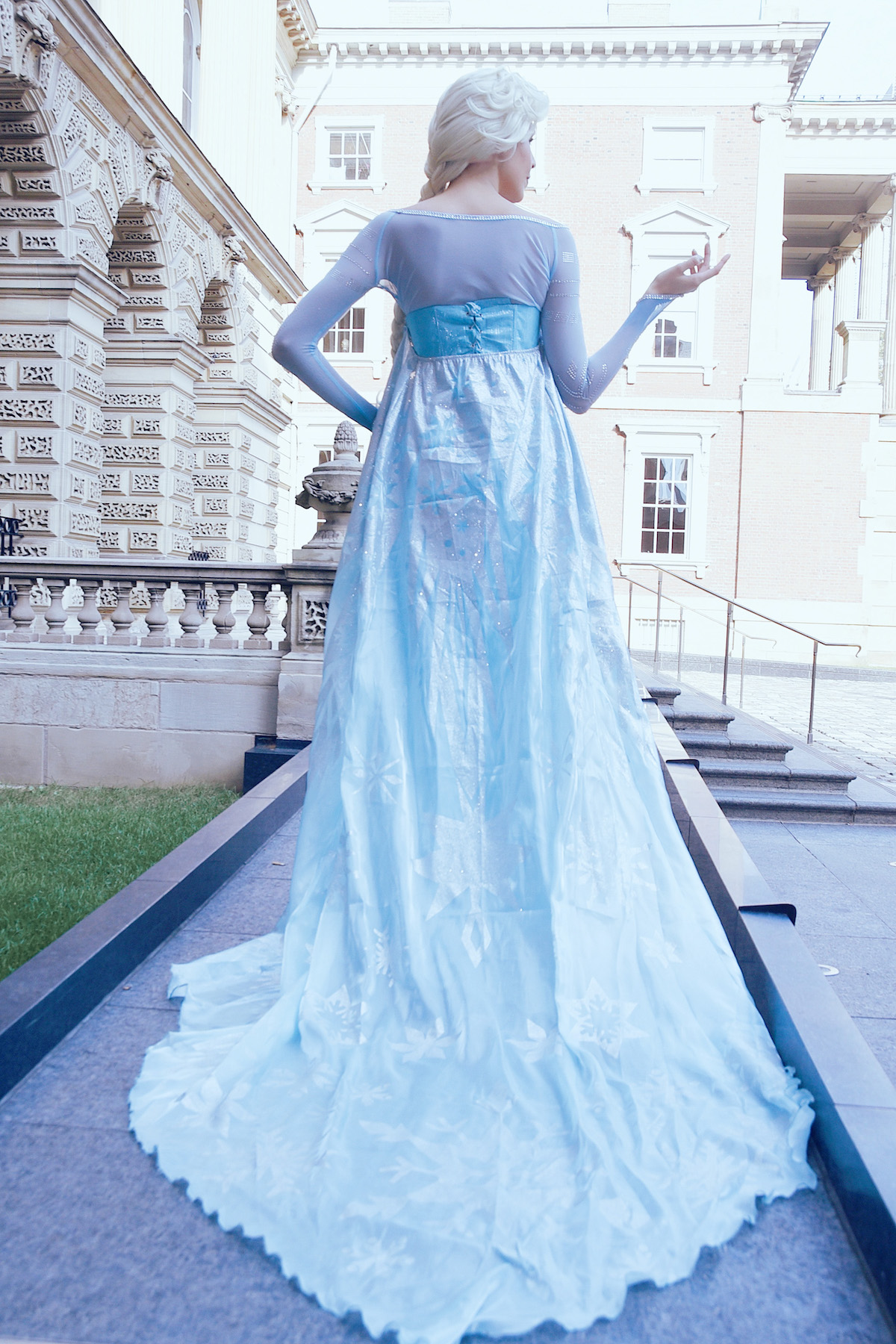 Elsa is facing away from the camera, ready to Let it Go
